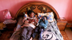A scene from Salero: Moises Chambi Yucra and his son Maykel at home.