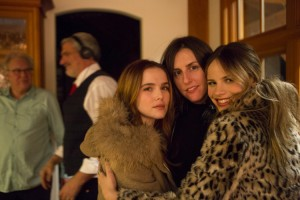 Zoey Deutch (left), director Ry Russo-Young (center), and Halston Sage (right) on the set of Before I Fall